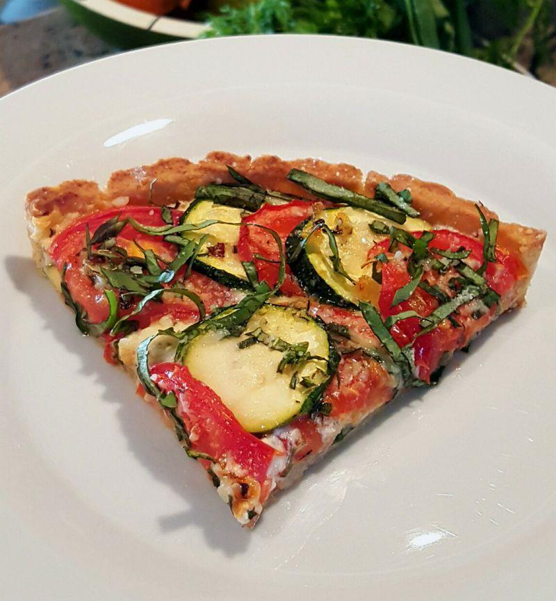 Tomato zucchini tart slice